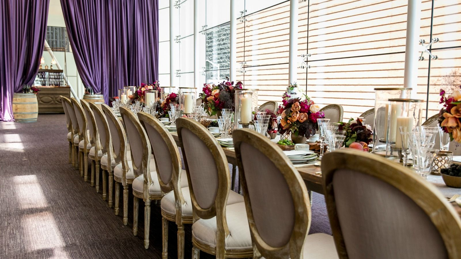 A long dining table perfectly laid out inside The St. Regis San Francisco wedding venue