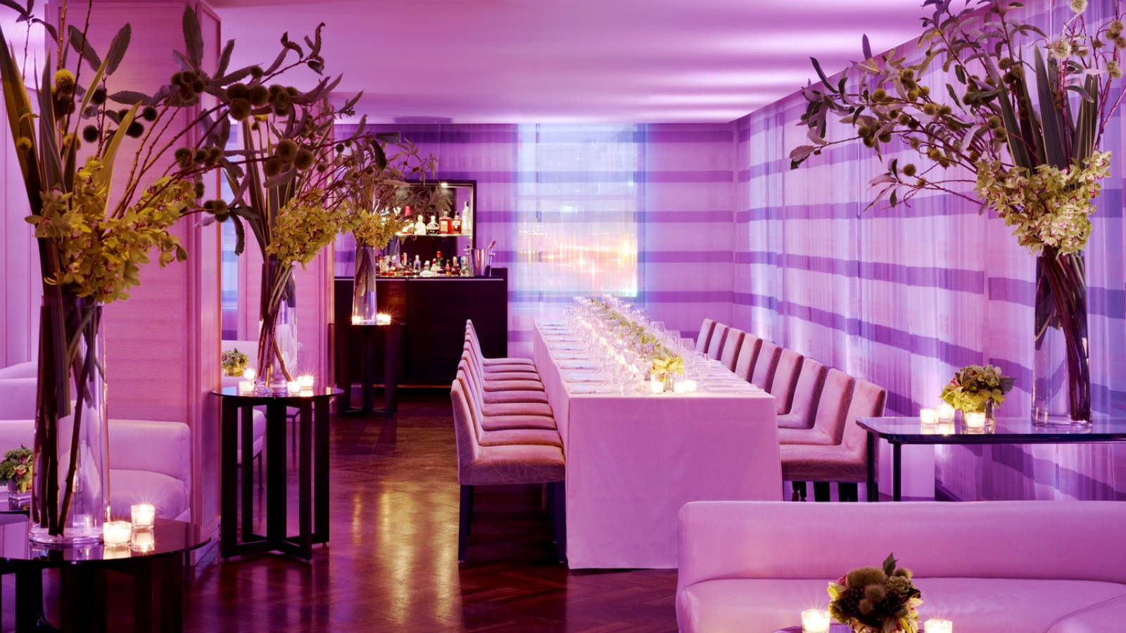 Vitrine event space with magenta lighting