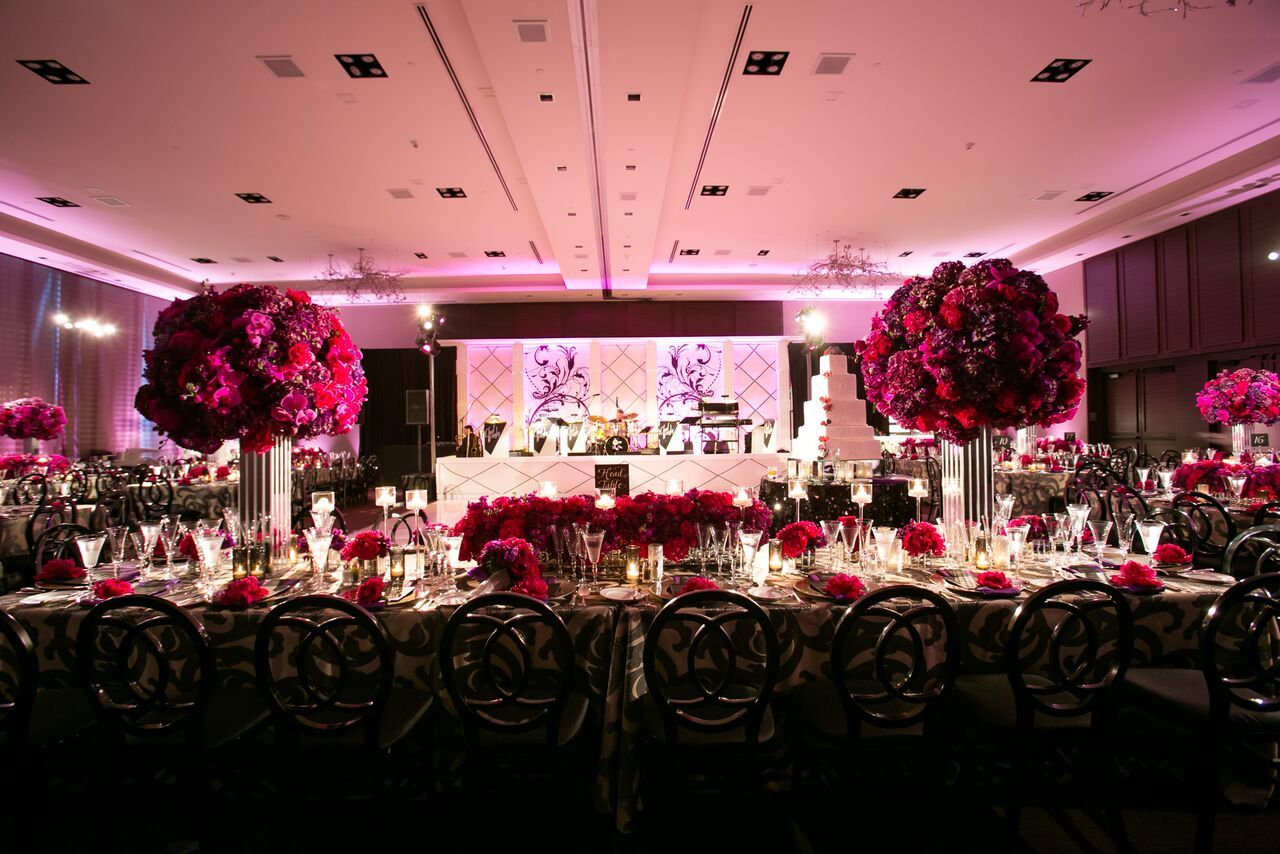 Colorful florals beautifully fill the ballroom for a St. Regis wedding