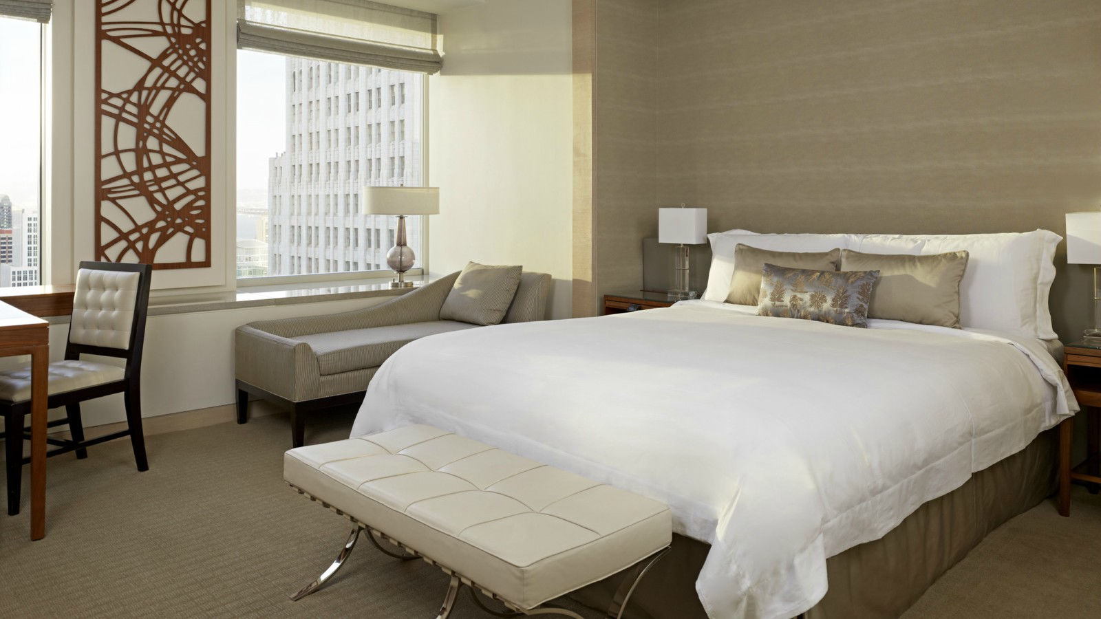 A photograph featuring a freshly laid double bed inside a Deluxe Guest Room at 5 star hotel, St. Regis SF